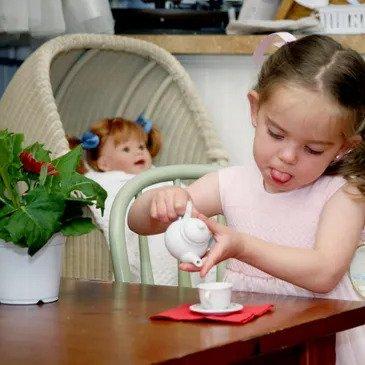 Toddler Playing Tea House